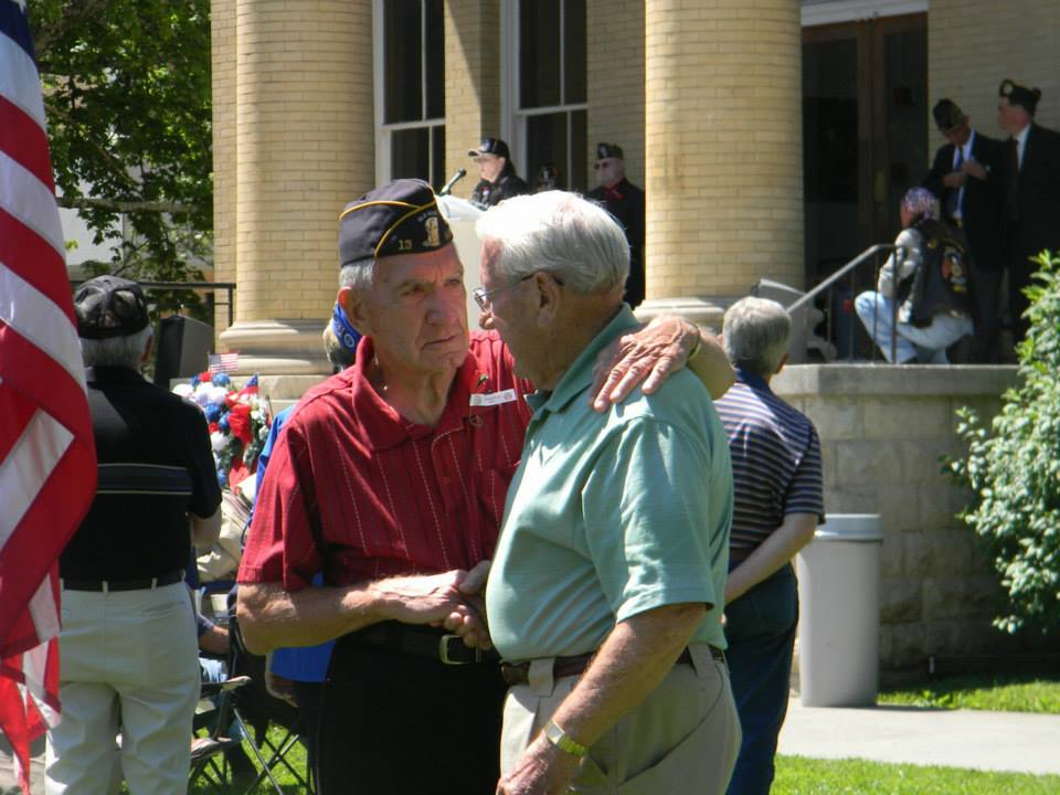 Two older men shaking hands